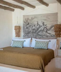 Ein Zimmer in der Unterkunft CASA CAT BA Beachfront Boutique Hotel