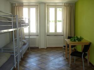 Litera o literas de una habitación en Hostel Lion Lodge Luzern