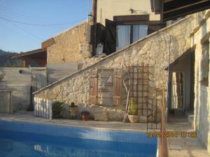 The swimming pool at or near Oinochori