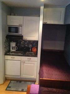 A kitchen or kitchenette at Ämmän Hotelli