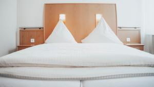 Ein Zimmer in der Unterkunft Avantgarde Hotel