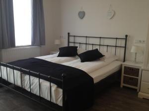 Een bed of bedden in een kamer bij Bed & Breakfast Villa Elisabeth