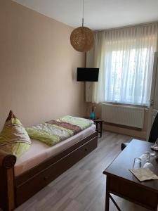 Ein Zimmer in der Unterkunft Pension No. 55