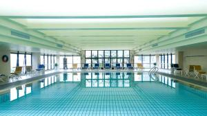 The swimming pool at or near Hotel Equatorial Shanghai