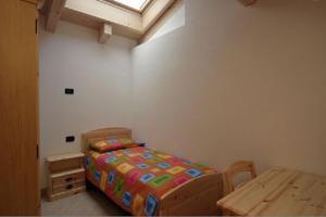 Postel nebo postele na pokoji v ubytování Appartamenti Li Desja