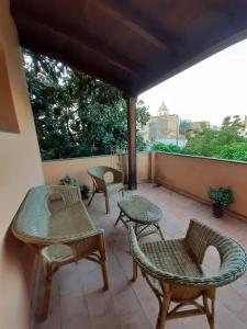 A porch or other outdoor area at Residenza d'Epoca Regina d'Arborea
