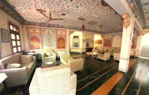 The lounge or bar area at Sajjan Niwas