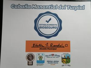A certificate, award, sign, or other document on display at Cabaña Privada Manantial del Turpial
