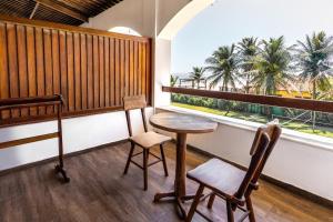 A balcony or terrace at Vila Coqueiros Boutique Hotel