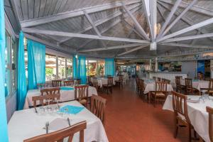 A restaurant or other place to eat at Il Gabbiano Camping Village