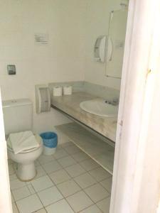 Um banheiro em Pousada Mainá