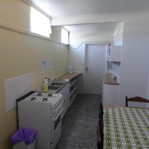 A kitchen or kitchenette at Turn-in Motel