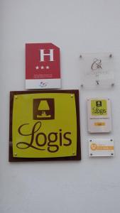 A certificate, award, sign, or other document on display at Logis Hôtel La Caravelle