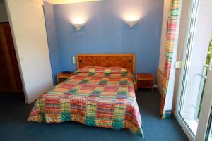 Кровать или кровати в номере Le Kirchberg