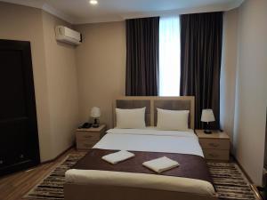 Um quarto em Gold Hotel Quba