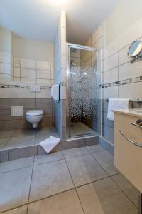 Salle de bains dans l'établissement La Commanderie de Champarey