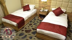 Um quarto em Roshan Al Azhar Hotel