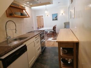 A kitchen or kitchenette at Aberlour Bolthole