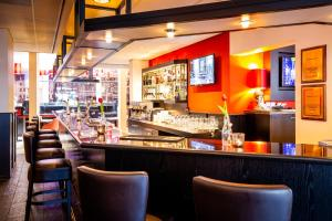 A restaurant or other place to eat at Bastion Hotel Maastricht Centrum