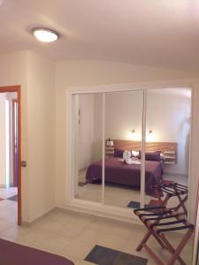 Letto o letti a castello in una camera di Aparthotel El Cerrito