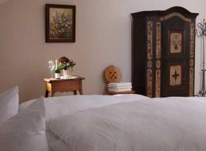 Ein Bett oder Betten in einem Zimmer der Unterkunft Hotel Restaurant Café Rapp