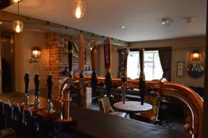 A restaurant or other place to eat at The Forresters Arms Kilburn