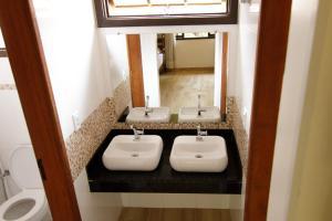 Um banheiro em Hostel Refúgio