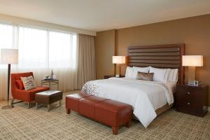 A bed or beds in a room at Renaissance St. Louis Airport Hotel