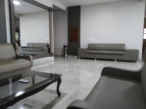 O lounge ou bar de Sleep Hotel Assis