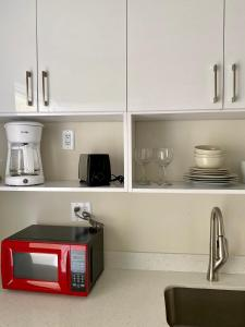 A kitchen or kitchenette at Diane Oceanfront Suites