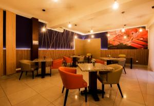 A restaurant or other place to eat at El Tambo 2