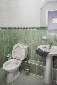 Ванная комната в Дом Охотника