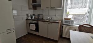A kitchen or kitchenette at Restaurant Haus Medaillon