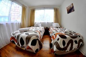 Una habitación en ValpoGo Apartments