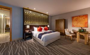 Um quarto em Ramada Al Qassim Hotel & Suites, Bukayriah