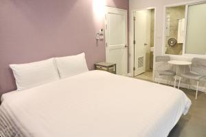 A bed or beds in a room at Kata Bai D - SHA Plus