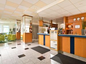 Лобби или стойка регистрации в ACHAT Hotel Monheim am Rhein