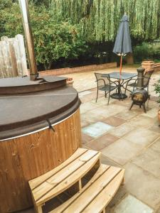 A porch or other outdoor area at Tewin Bury Farm Hotel