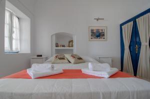 Ένα ή περισσότερα κρεβάτια σε δωμάτιο στο Astraea House