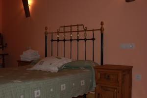 A bed or beds in a room at El Jardin de la Huerta