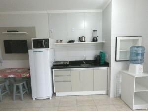 A cozinha ou cozinha compacta de Residencial Florida ll - 150mt Praia de Mariscal