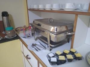 A kitchen or kitchenette at Pousada Bela Vista