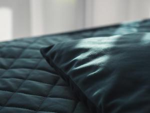 Łóżko lub łóżka w pokoju w obiekcie Hotel Termalny