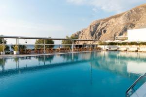 The swimming pool at or near Kamari Beach Hotel