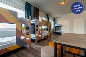 A bunk bed or bunk beds in a room at a&o München Hackerbrücke