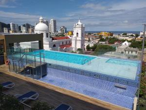 The swimming pool at or near Hotel Catedral Plaza