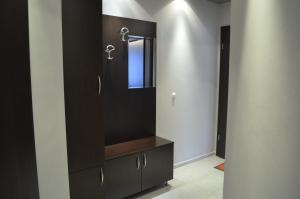 A television and/or entertainment center at Apartments Kali