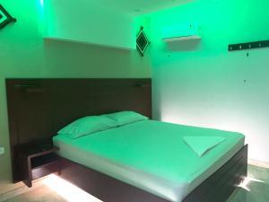 Una habitación en Hotel Raquel Rosado