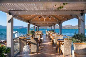 A restaurant or other place to eat at Elounda Akti Olous (Adults Only)