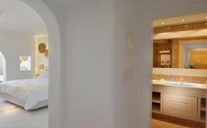 A bed or beds in a room at Saint John Hotel Villas & Spa